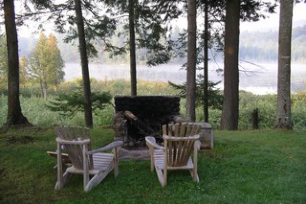 Outdoor fireplace and view of Horseshoe Pond