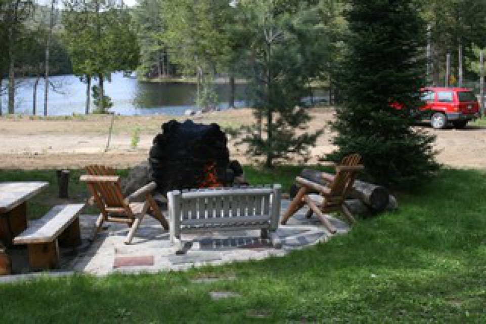 Fire pit with chairs and picnic table.