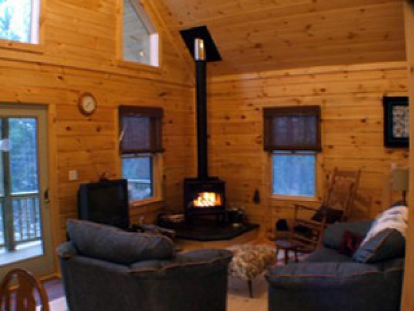 Living room/woodstove area. Firewood provided.