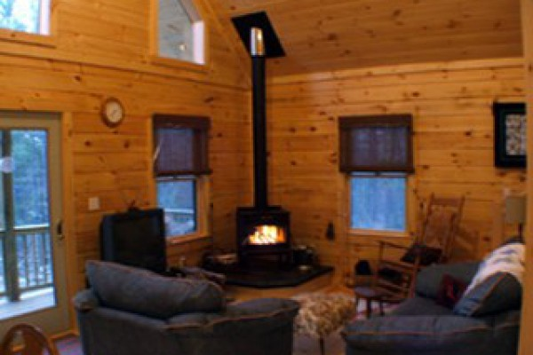 Living room/woodstove area. Firewood provided.