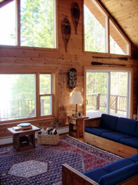 Great room with a wall of windows facing the lake