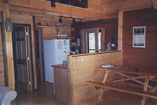 The kitchen area with all appliances