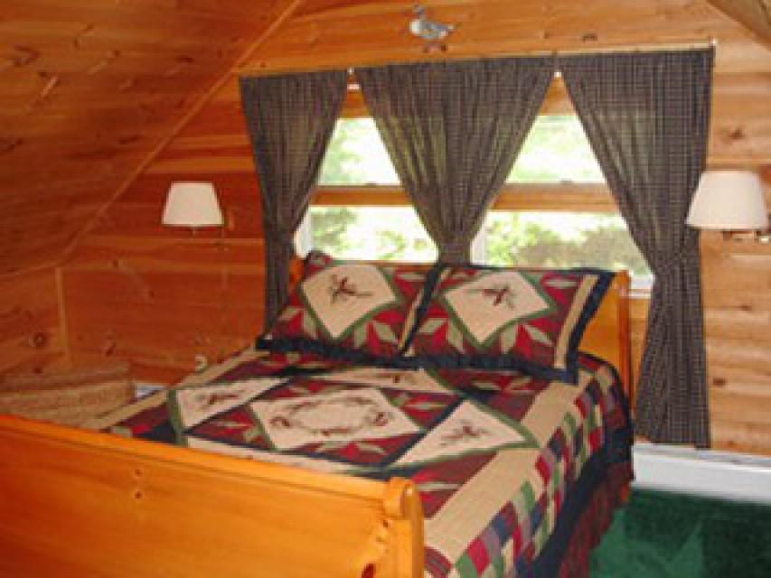 Queen sleigh bed in the loft