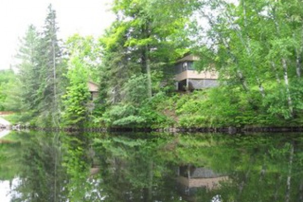 View of larger cabin, Balsam, from the lake.
