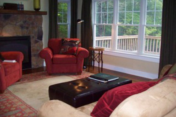 Living room with water view and propane fireplace