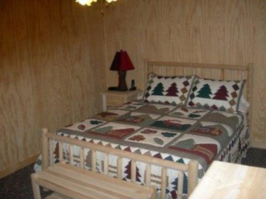 One of the two bedrooms in basement