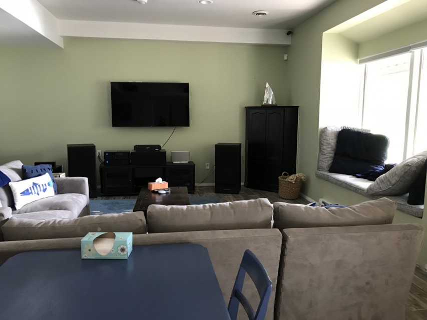 Basement game room with home theater and window seat