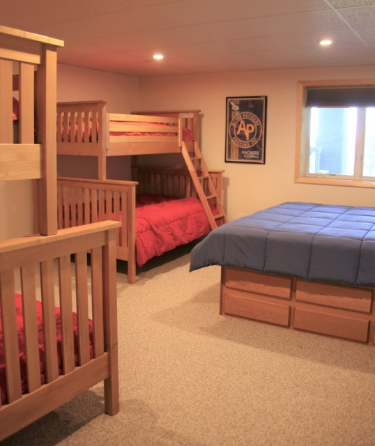 Bunkroom in Basement with king bed and two bunk beds
