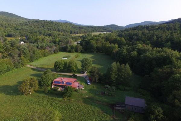 aerial view of property shows house and barn