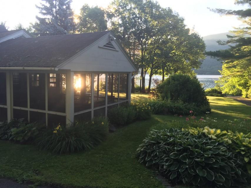 House overlooking lake - morning sunshine