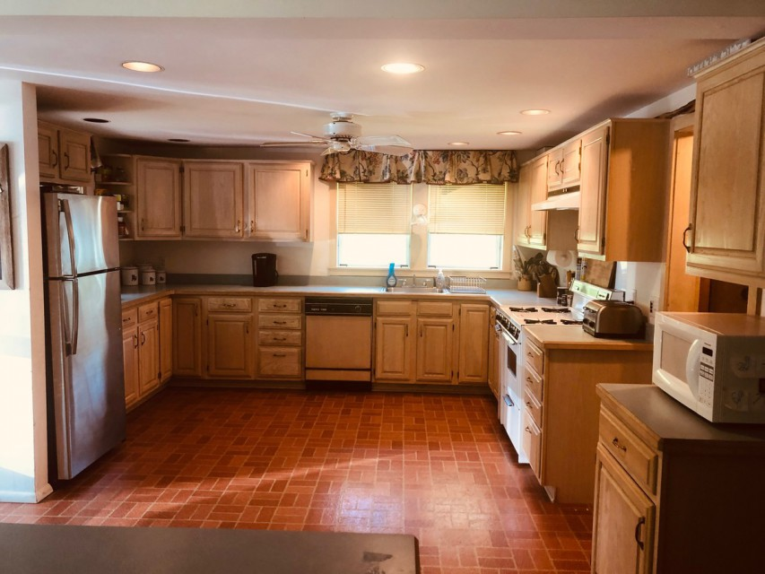 Large kitchen fully open to family room and dining area
