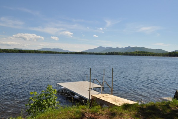 Dock with stairs into the clear, sandy lake floor