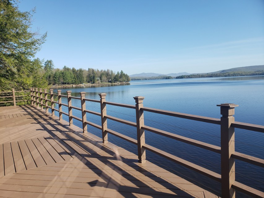 Large deck overlooking the lake, plenty of deck /chairs