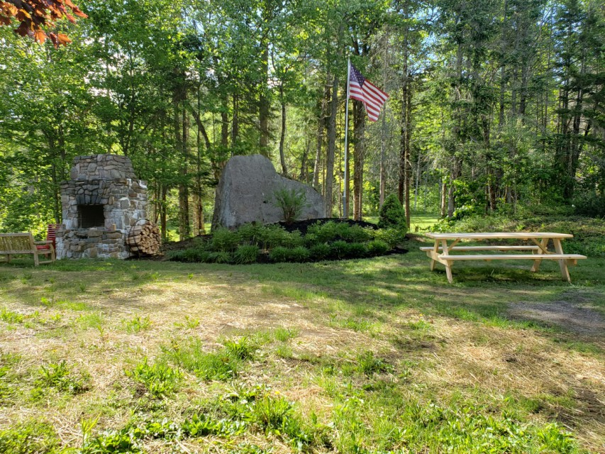 Side yard w/large fireplace and great views of the lake