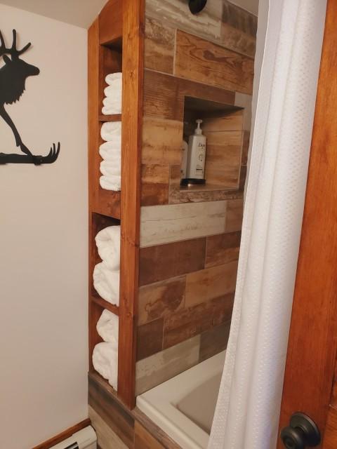 Luxury  Bath Towels/ Custom Tiled Shower w/ Deep Tub