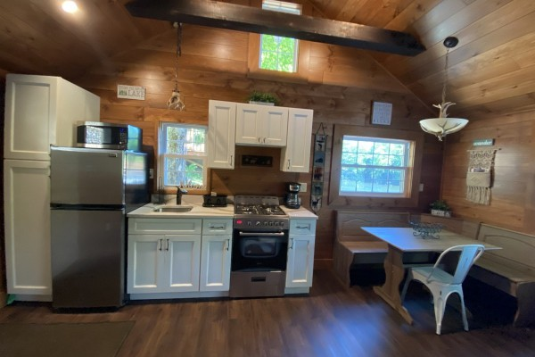 Kitchen with a dining nook in cottage #2
