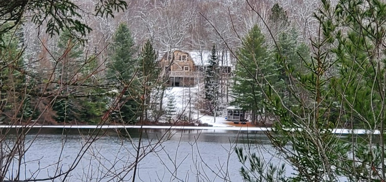 Lodge from opposite shore of Bass Lake