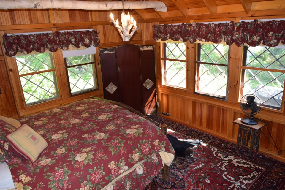 Master bedroom with king bed and view of the water
