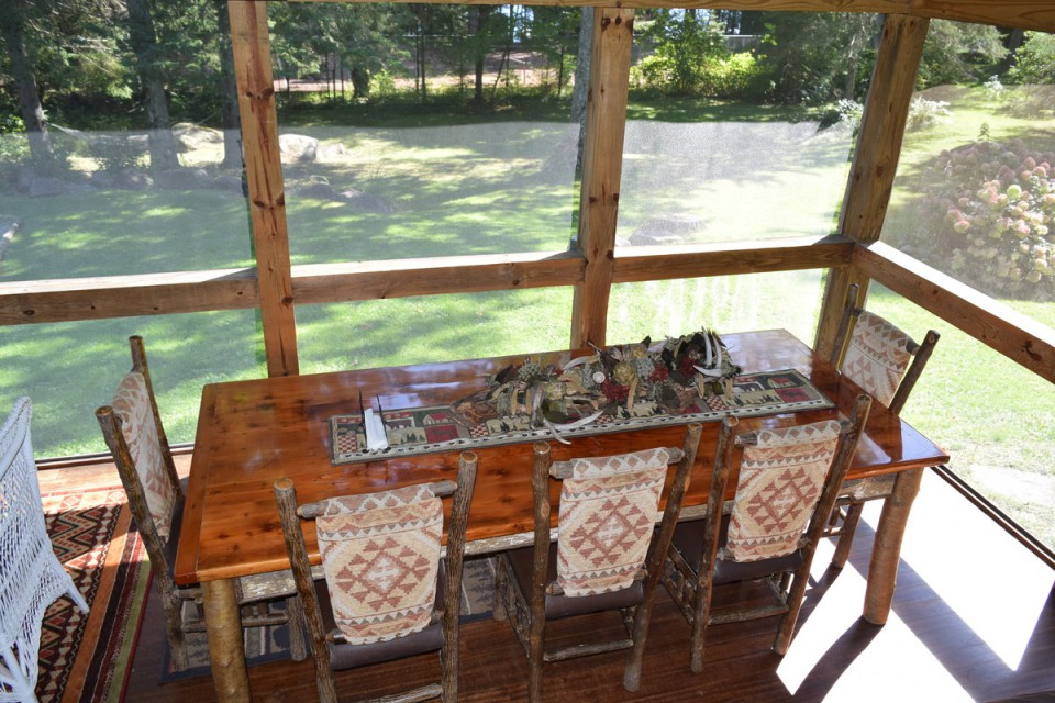 Screened in porch, Adirondack dining table seats 12