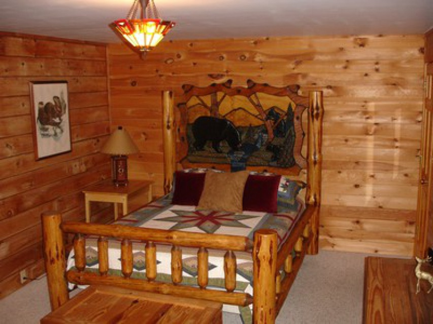 Master bedroom with hand-carved bear bed