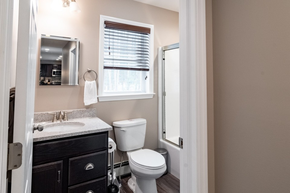 2nd Bathroom with hairdryer & storage.