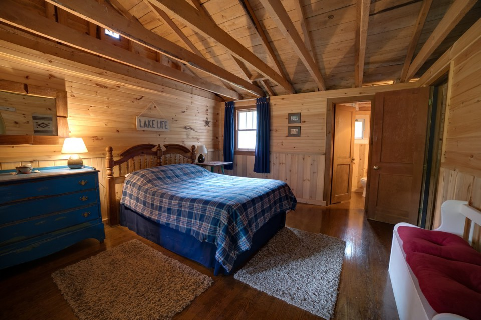 One of four bedrooms in the three cabins