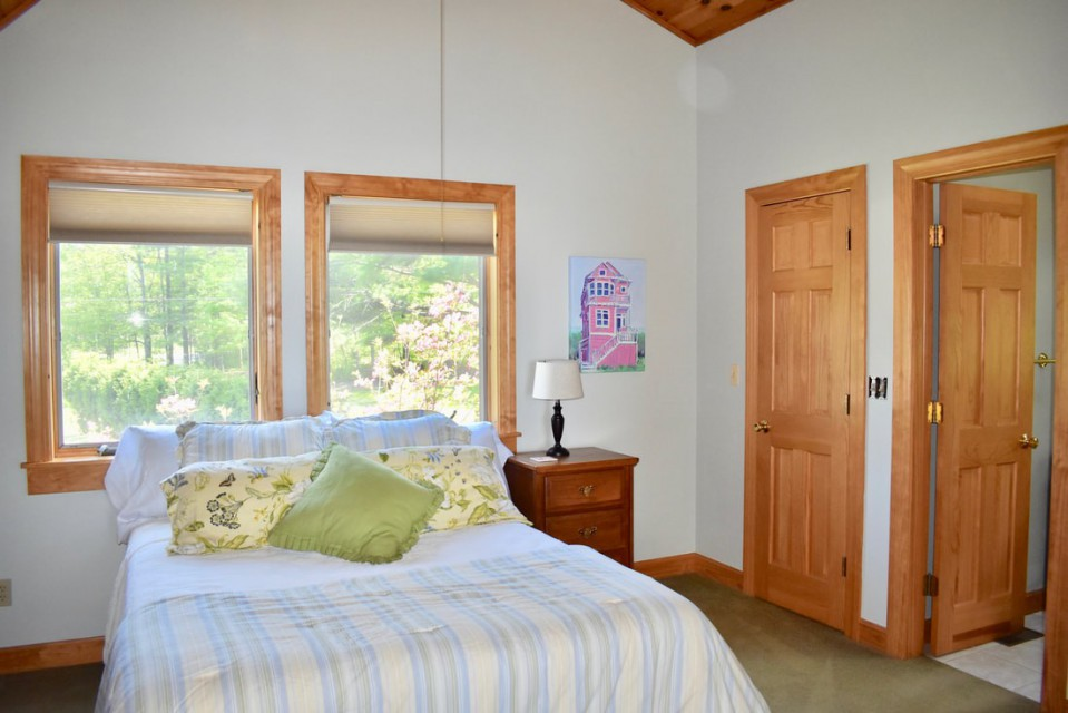 master suite with full bath and loft