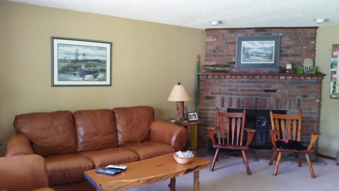 living room w/ fireplace for cozy winter fires