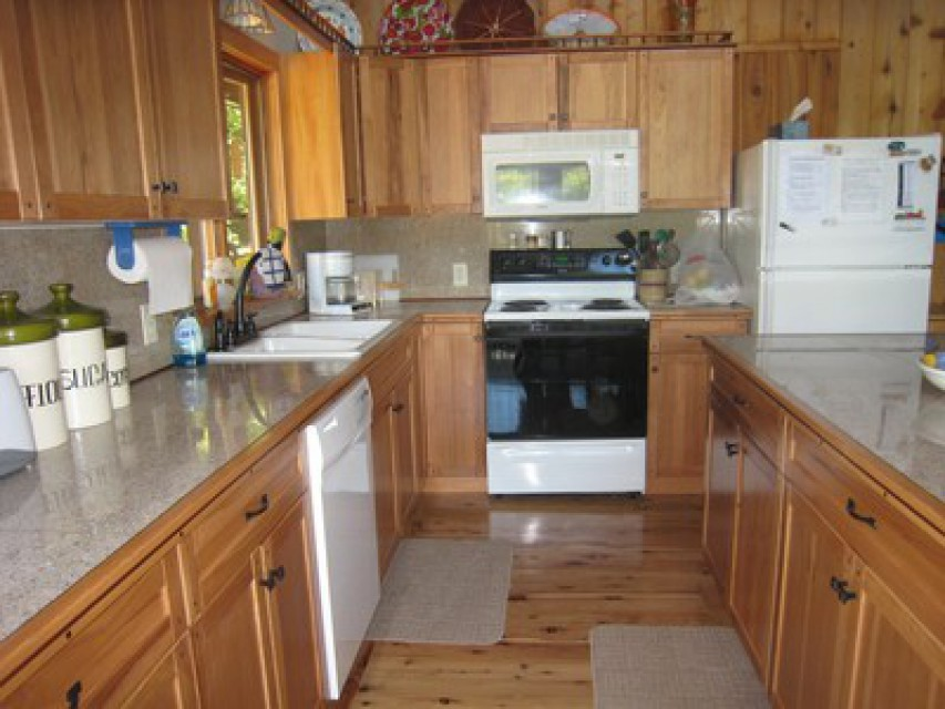 Well-stocked, perfect kitchen with granite countertops