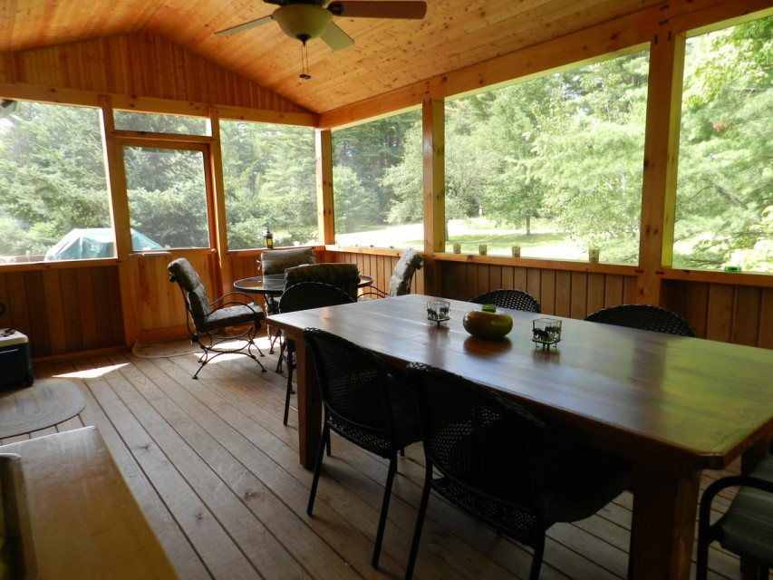 Screened-in porch with 2 tables, Weber grill on deck