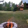 Firepit in the yard, plenty of wood in the woodpile