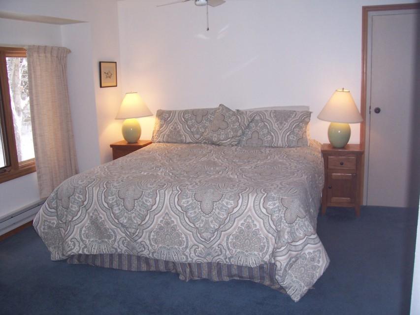 Our master suite: king bed, desk, powder room, bathroom