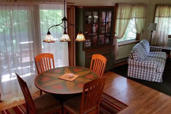 Bright Dining Room is open to Living Room & Deck