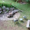 Peaceful yard has fire pit, picnic table & swing set