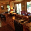 Full size open galley kitchen with lake views