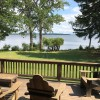 Large mahogany deck spanning entire front of house