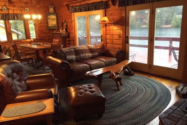 Cozy living room w/fireplace opens to the upstairs deck
