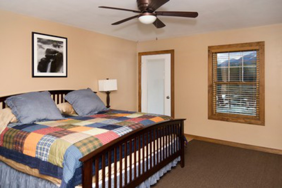 Enjoy the view in this guest bedroom with a King Bed