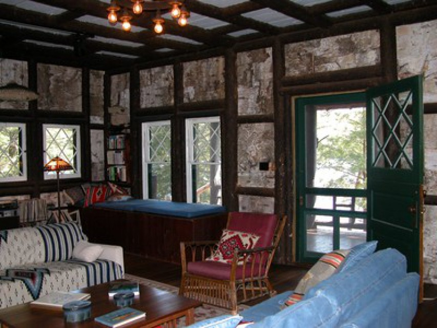 Great room with 8 foot fireplace, birch bark walls