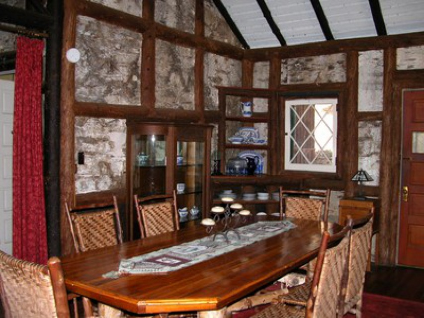 Dining room with large fireplace. Original antiques.