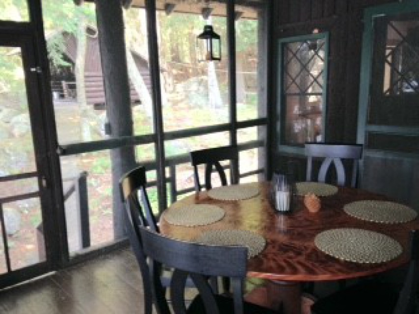 Charming screened in porch. Walk-out from MB suite.
