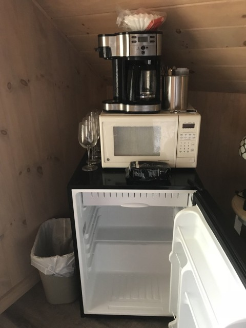 Studio has a fridge, microwave, and coffee maker.