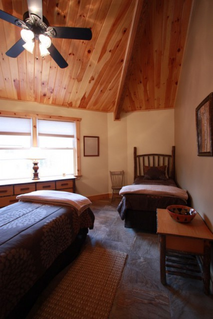 Adirondack style twin beds and furniture on 2nd floor