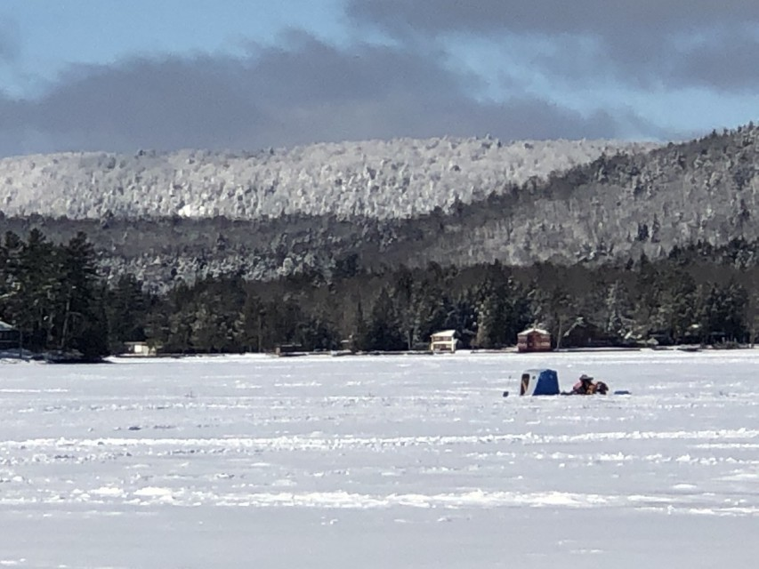 Ice Fishing in Front of Cottage