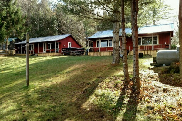View of cottages from side door of main camp.