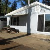 Retractable awning provides shade over picnic table