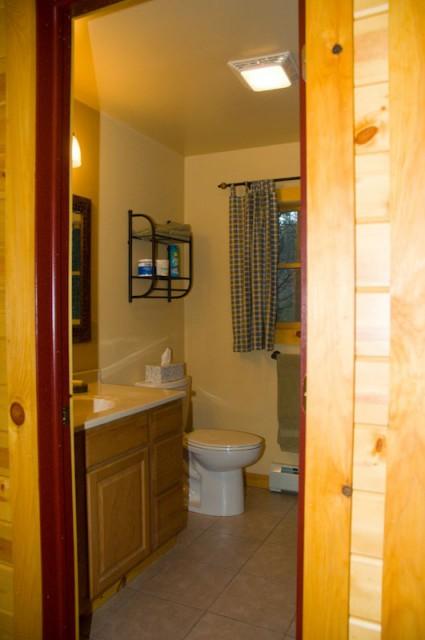 Bathroom with oversized shower.  Hallway to bedrooms.