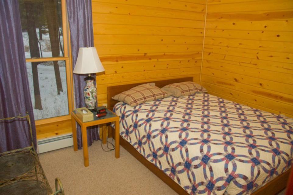 Bedroom with queen and walk-in closet