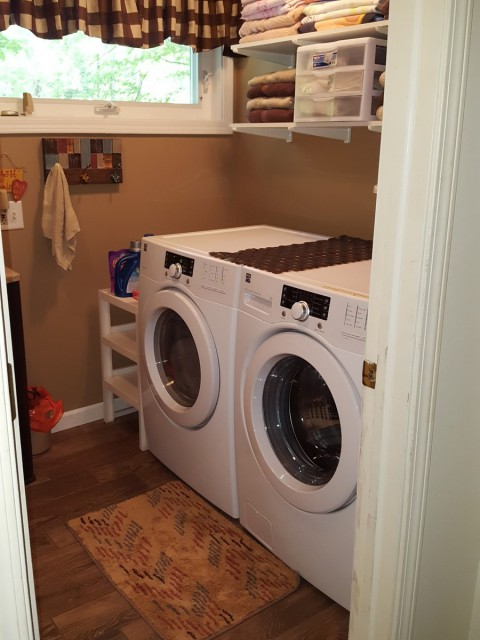 Upstairs full bath with laundry.