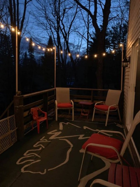 outdoor deck with cafe lights. facing channel.